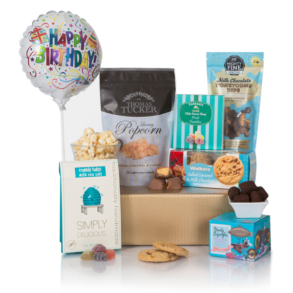 A Birthday Gift to remember starts with Balloons and plenty of treats to share. We have put together the beginnings now you need the participants for the enjoyment. Includes: Happy Birthday Balloon, Simply Delicious Seasalt Fudge 125g, Monty Bojangles Flutter Scotch Curious Truffles 100g, Walkers Salted Caramel & Milk Chocolate Cookies 150g, Thomas Tucker Salted Caramel and Vanilla Popcorn 125g, Mighty Fine Milk Chocolate Honeycomb Dips 90g and Farrah's Fruit Pastilles 125g. Presented in a Gold Gift Box