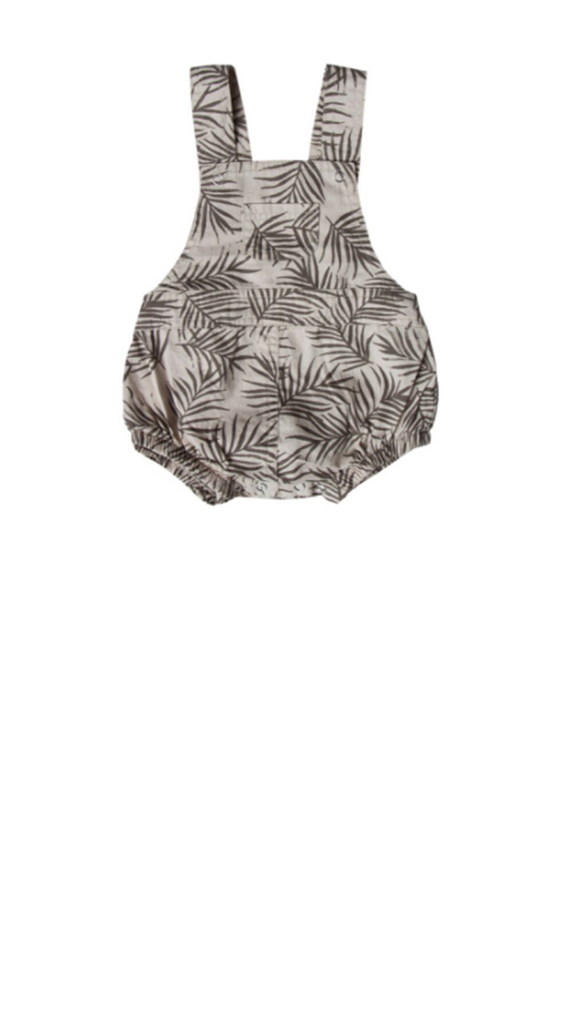 Grey overall style baby girl bubble romper with charcoal colored palm leaf print throughout