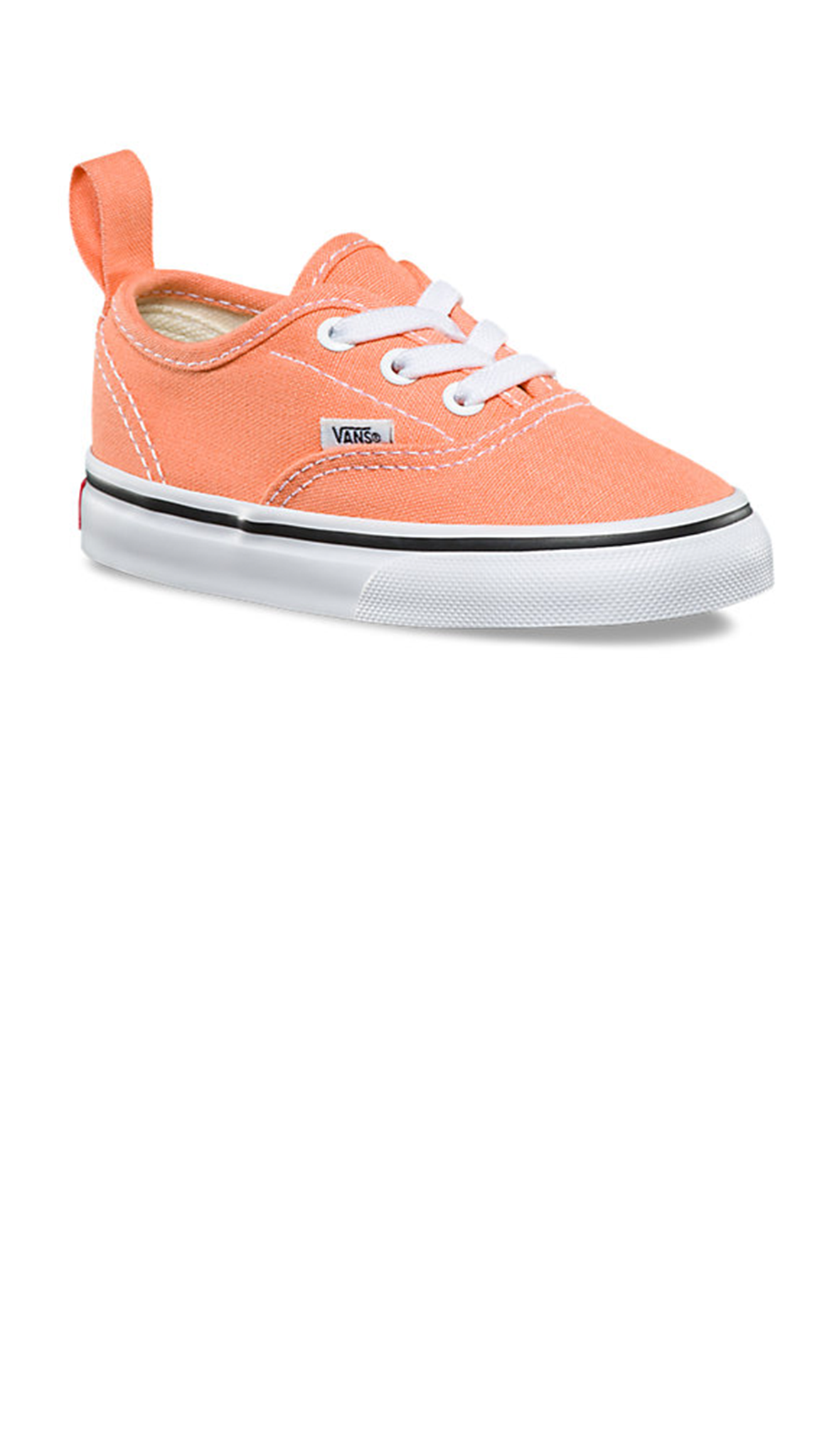 peach colored girls sneakers with white sole and laces