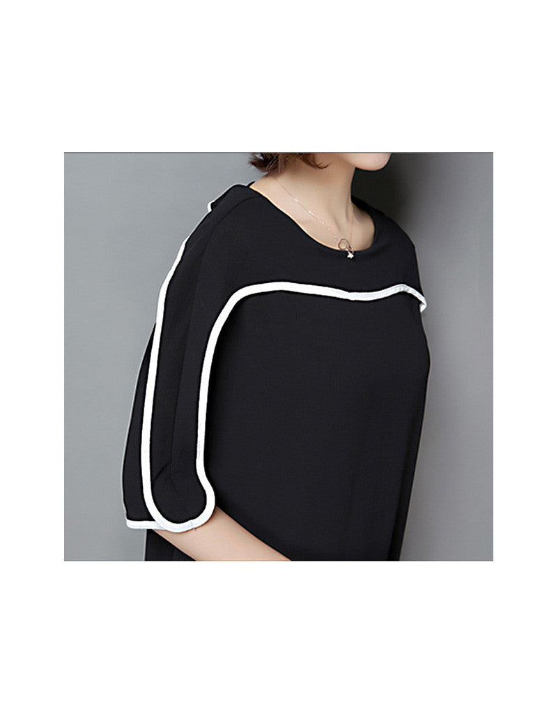 Monochrome mid-length sleeve top with pleated skirt