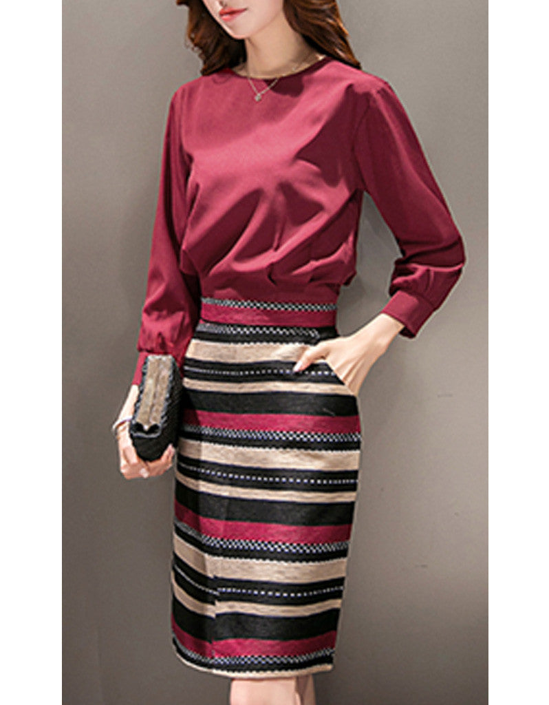 Long sleeve top with mid-length multi-coloured skirt