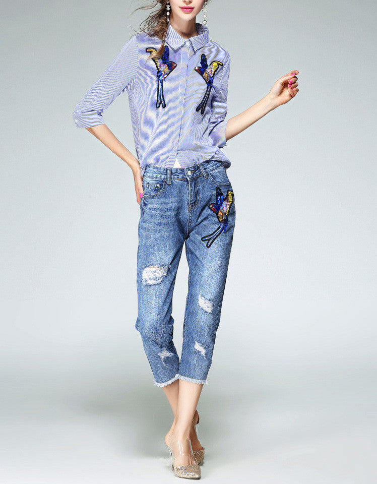 Distressed jeans with birdie design in sequins, beads and embroidery