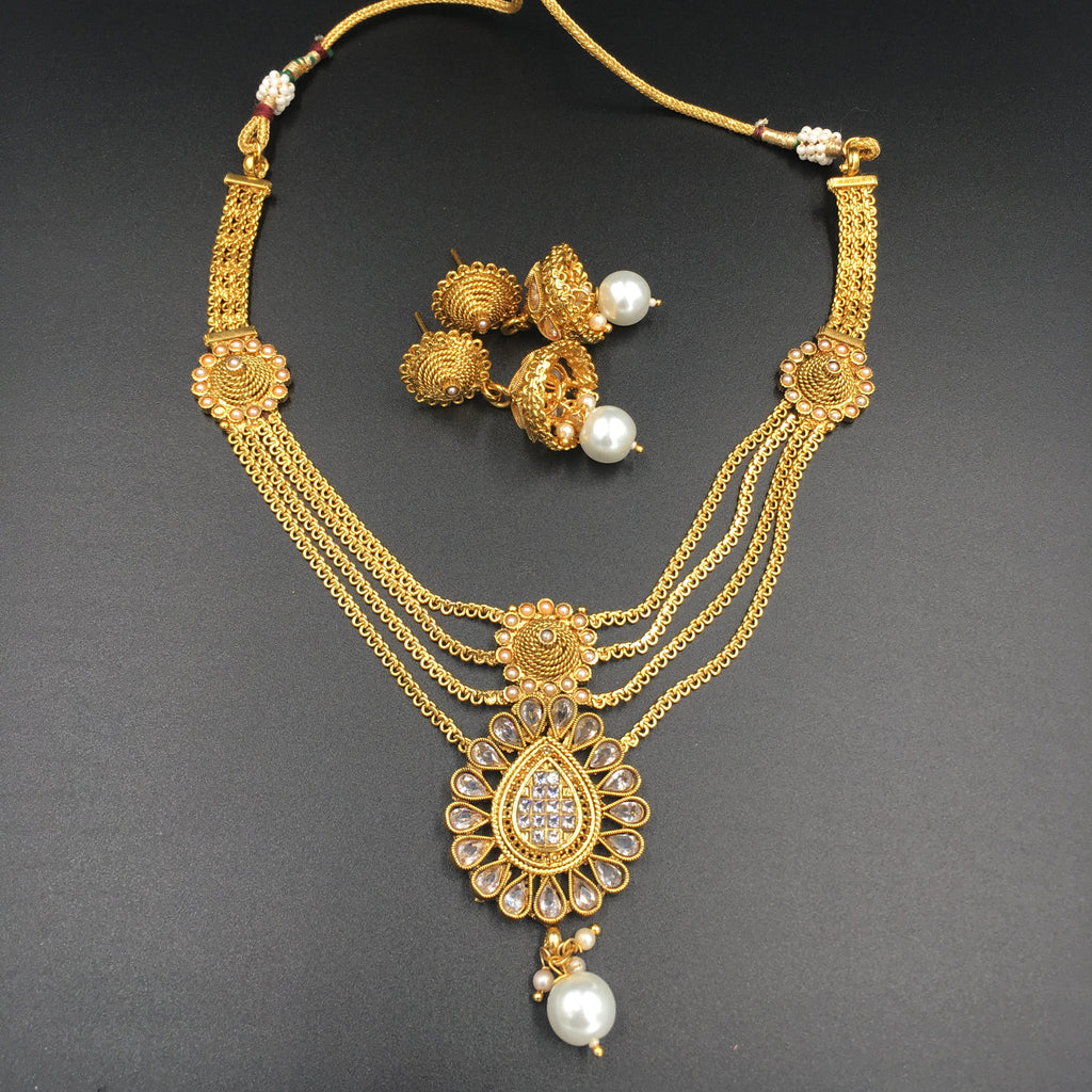 Four golden string necklace with Moti and Jhumki earrings