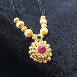 KOPM - Round pendant with green and Pink Stone and golden beads