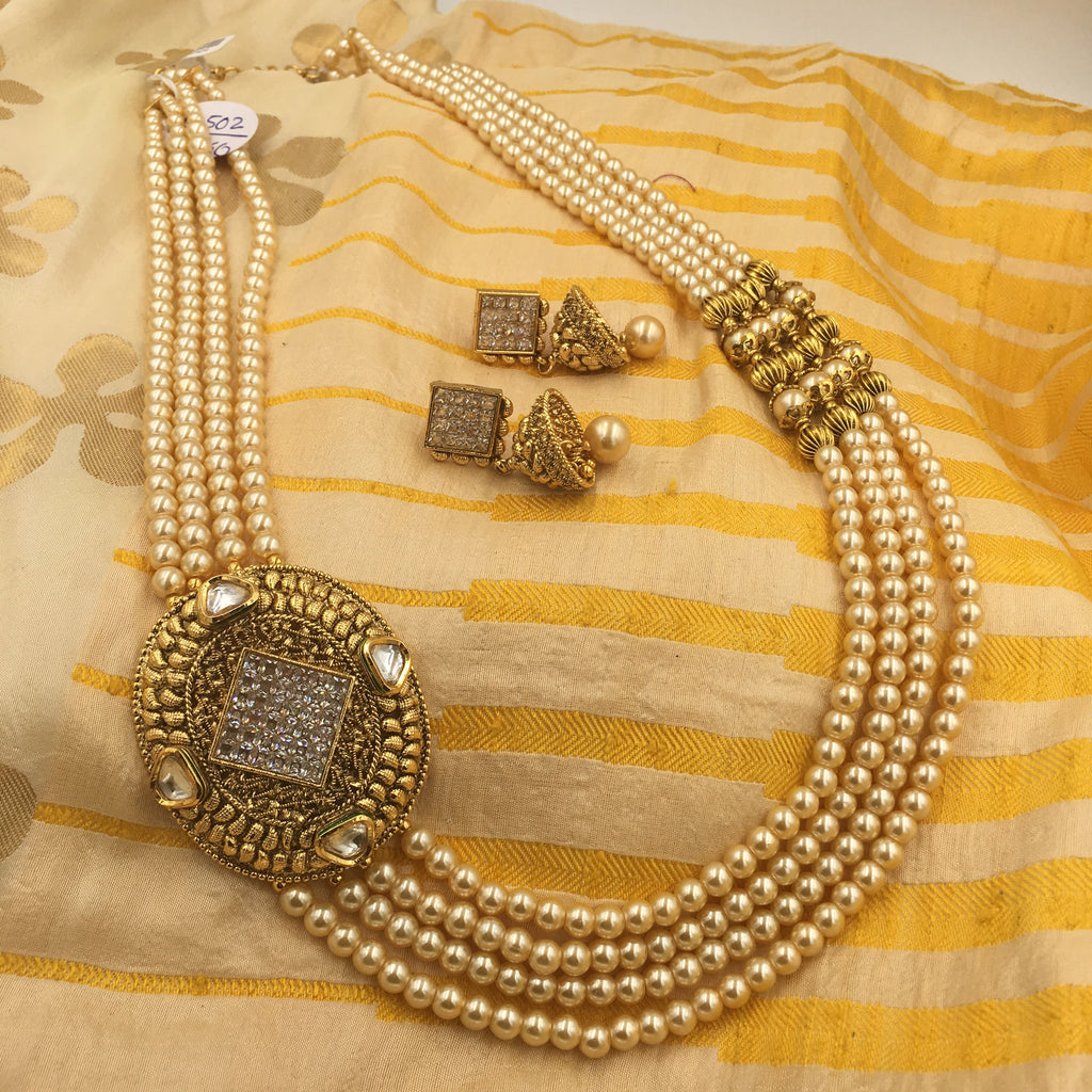 Long Moti necklace with oval side pendant and white stones