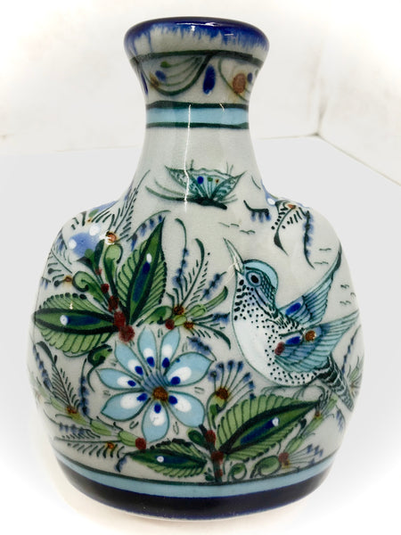 vase in blue rim with bird, flowers and butterfly