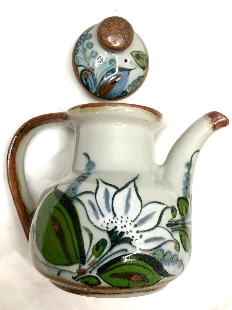 Tea Pot with lid in small size, brown trim with grey background.