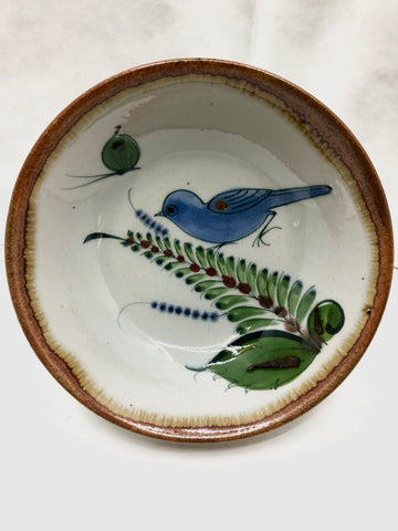 Ken Edwards bowl with a brown rim and a bird, butterfly, and leaf in the interior.