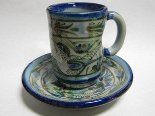 Ken Edwards Collection Espresso Set with blue rims on cup and saucer set.  Outside is decorated with plant life and wild life.