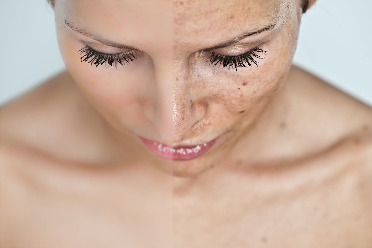 Woman looking down with half of face damaged by sun