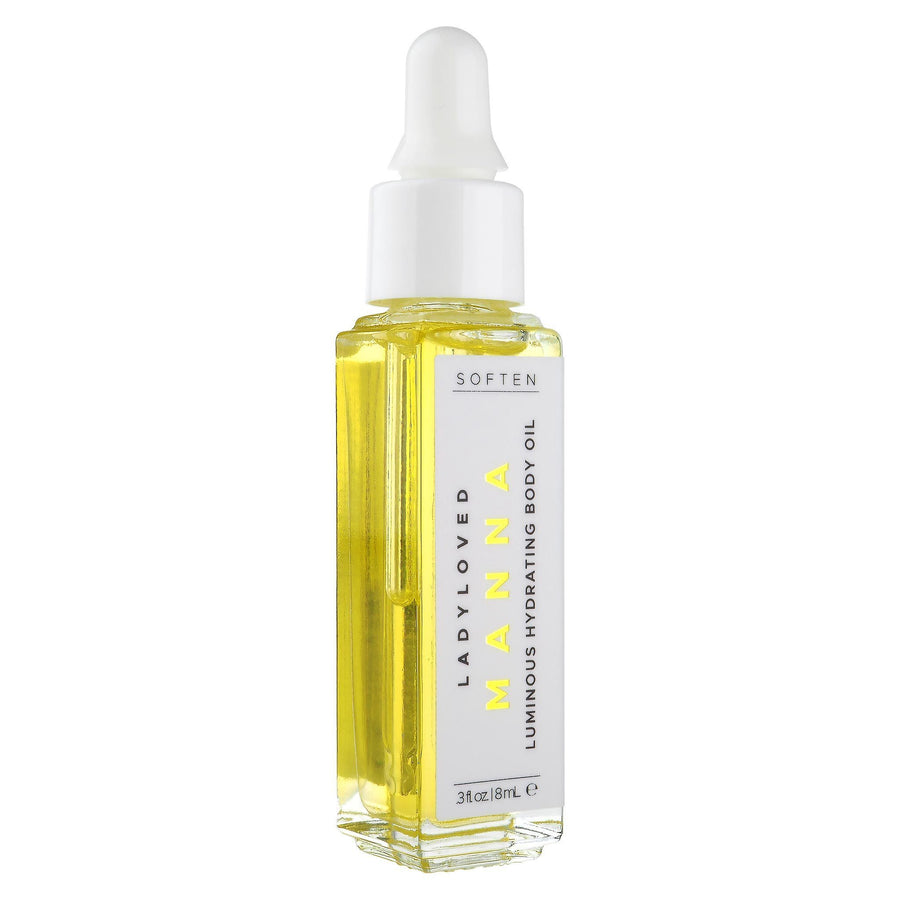 An image of a 2 ounce bottle of Manna Moisturizing Body Oil laying face up.