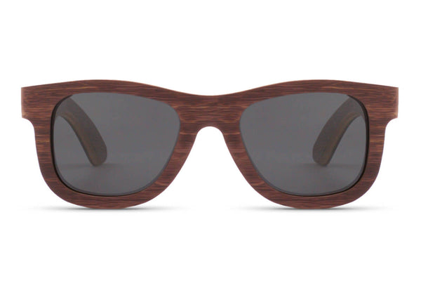 Front of glasses view. Created from repurposed skateboard deck with a natural brown hue, these glasses are designed for the bold. edlee sunglasses are always made from the highest quality products including our sustainable and eco-friendly bamboo. Our wooden sunglasses are designed to be lightweight and comfortable with polarized lenses to ensure the best possible vision.