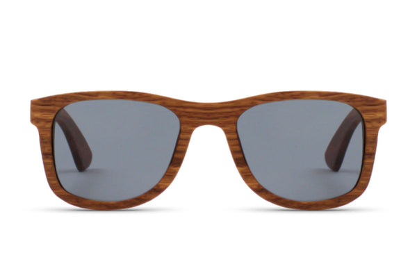 Front of glasses view. The Rosewoods might just be our brightest glasses yet, with hints of red naturally accentuating  the deep wood grain. The natural color of bamboo is highlighted in order to get the purest, most true-to-life style. edlee sunglasses are always made from the highest quality products including our sustainable and eco-friendly bamboo. Our wooden sunglasses are designed to be lightweight and comfortable with polarized lenses to ensure the best possible vision.