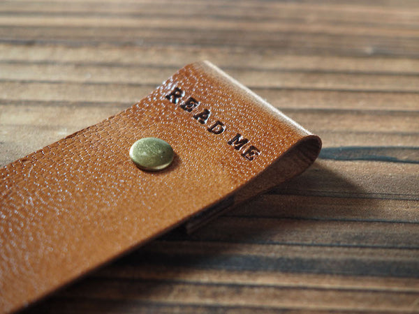 ES Corner Handmade Japan Goat Skin Leather Bookmark Close up with READ ME text Brown