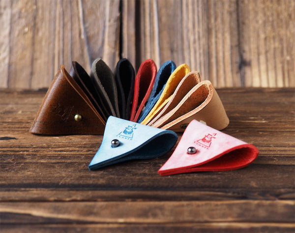 ES Corner Leather Cord Organizer 11 colors Blue Red on a wooden tray