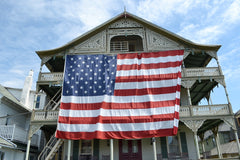 Giant US flag on Victorian shore house