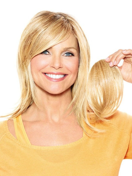 Color HT25 = Medium Golden Blonde | Full Sweeping Side Fringe Clip In Bang by Christie Brinkley