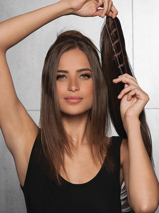 The Invisible Extension by Hairdo adds 20 inches of length and beautiful volume in just a few easy steps