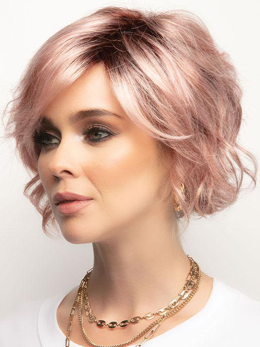 A chin length textured bob with trendy, side swept fringe
