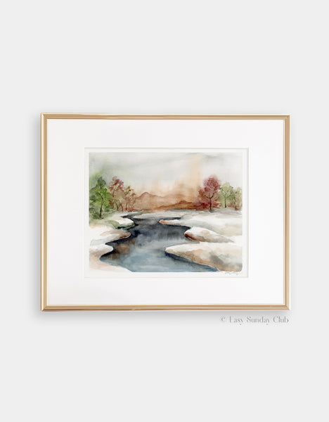 Gold framed mock up of icy stream divides watercolor landscape into two snowy fields