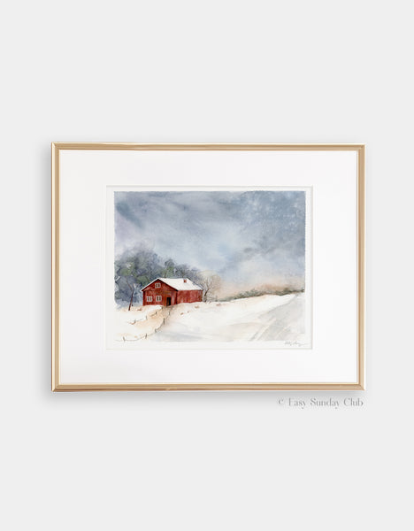 Gold framed mock up of singular red barn in snowy field with ominous gray clouds above watercolor landscape