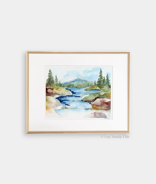 Gold framed mock up of rocky stream rolls down from a mountain tucked away in a forest watercolor landscape