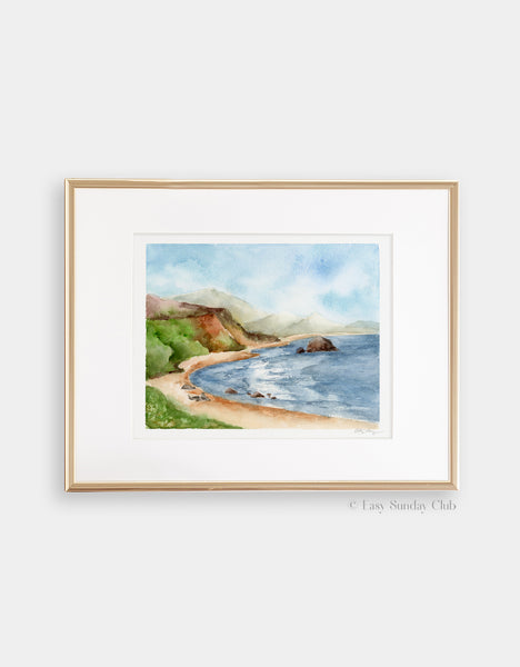 Gold framed mock up of blue ocean cove surrounded by green hills and three seals on the beach watercolor landscape