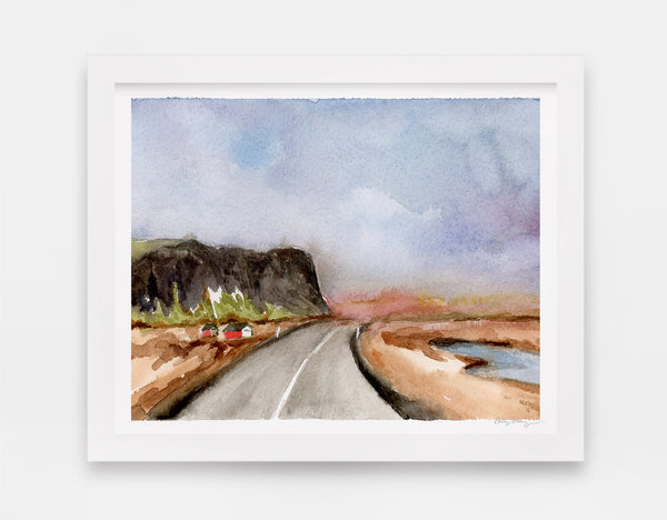watercolor landscape art with two red houses on the side of an open road with a large cliffside looming to the left