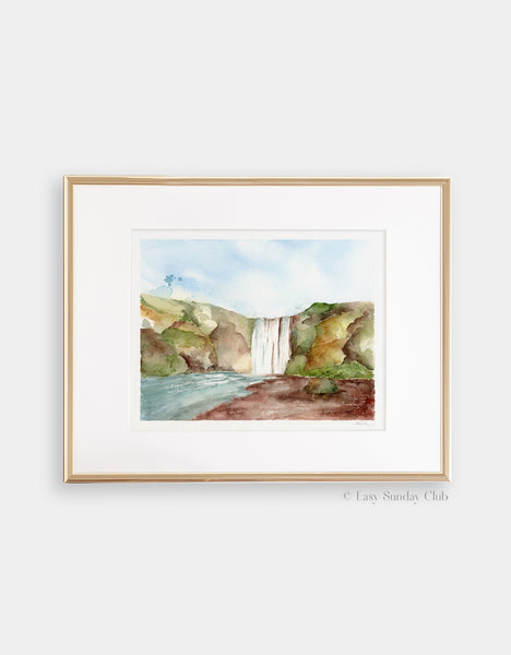 Gold framed mock up of giant waterfall in center of rocky green landscape watercolor