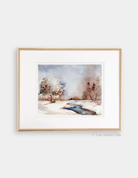 Gold framed mock up of Chilly frozen winter watercolor landscape featuring small stream in a park