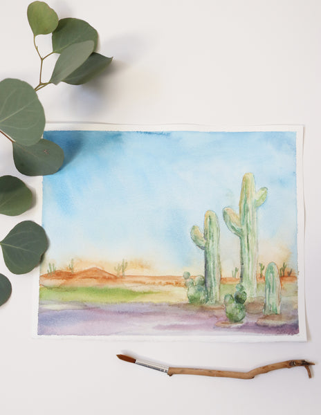 flat lay image of cactus watercolor in a desert landscape, desert themed art print with bright and saturated colors