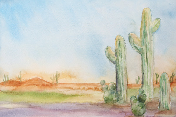 close up view of cactus watercolor in a desert landscape, desert themed art print with bright and saturated colors