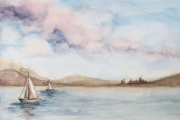 cotton candy skies with puffy clouds above a sailboat dotted lake watercolor landscape close up