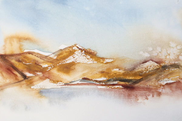 Rich earth-tone washes of color reveal a desert hill watercolor landscape close up