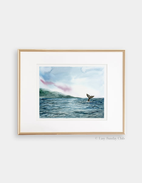 Gold framed mock up of velvet blue ocean ripples and gray whale tail in distance watercolor landscape