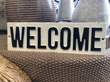 Cast iron sign 'WELCOME'