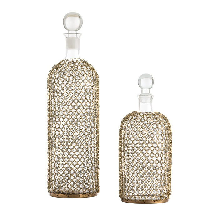 "Drexel Decanters, Set of 2  While each clear glass decanter in this exquisite set features an understand silhouette, the overall design is elevated by a delicate, antique brass chainmail mesh overlay.   The design is timeless and food safe to fill with your favorite.   Size: 4.5"" Dia  1) 11.43x 40.64 x 11.43 cm  2) 11.43 x 26.67 x 11.43 cm"