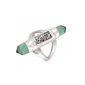 "Green Comet Ring - This handcrafted ring is made of 925 sterling silver. This piece features custom-made acrylic stones and Arabic calligraphy that reads ""عيناكي كالنجوم"" which translates to ""Your eyes are like stars"".  Color: Green  weight: 6.77g"