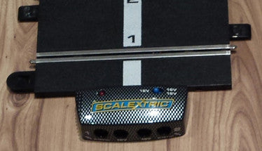 Why are there two power inputs on a Scalextric Sport Powerbase C8217?