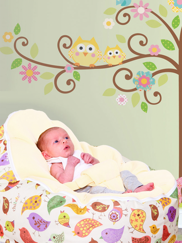 Baby Sitting in a Chibebe Chirpy Style Baby Bean Bag with Cream Baby Seat