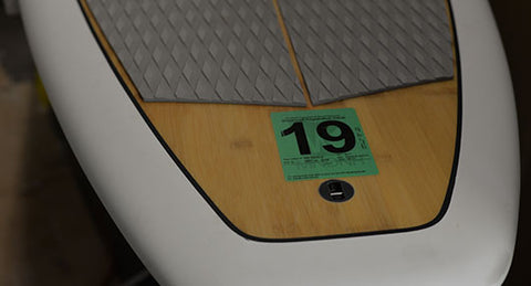 MN watercraft registration decal placement on a paddle board