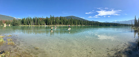 Clear water and paddle boards