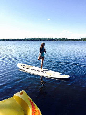 Lily doing YOGA on Paul Bunyan Paddle Board