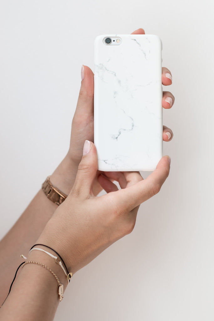 woman holding white marble Phone Case
