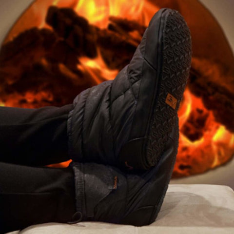 heated slippers in front of fireplace