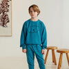 Little Boy Wearing Dark Green Organic Cotton Pigment Dyed Herbert Sweatshirt with Dog Print