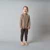 Brown cable knit sweater modelled by little girl laughing