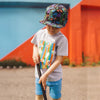 Kid wearing grey cotton summer tee with colourful stripes and fruits print