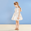 Little Girl Wearing Powder Blue and Rose Gold Metallised Giant Blue Bow Bodice Festive Dress