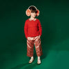 Little Girl Wearing Red Merino Red Sweater with Ribbed Neckline with Braided Detail on Chest and Sleeves